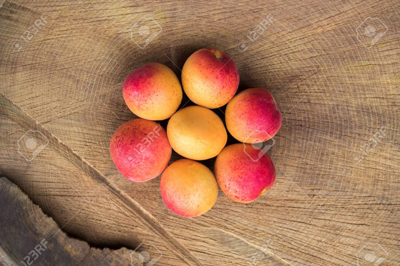 Apricot fruit. Fresh apricots on a wooden background. Close up flat lay photography - 127118745