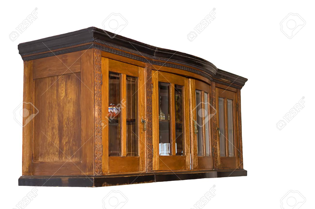 Old brown wooden kitchen cabinet suspended. Side view. With glass..
