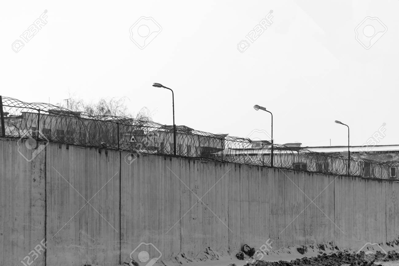 Fence With Barbed Wire, Place Of Detention, Prison. Black And ...