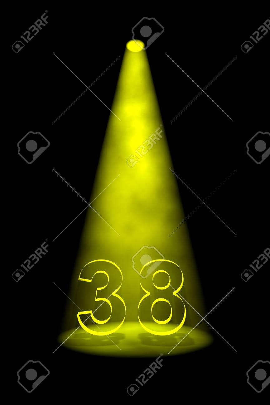 Number 38 illuminated with yellow spotlight on black background Stock Photo - 13588678