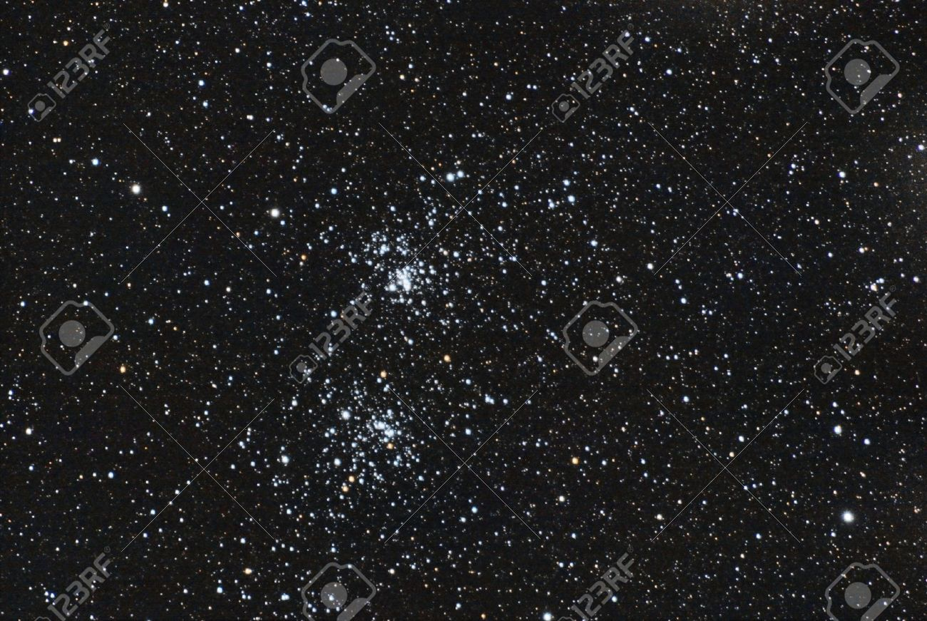 the famous stars double cluster in the constellation of perseus The image is taken in the in prime focus of professional telescope This is a very deep and real image, so the noise in background is no noise, these are very very dim stars again The image - 15797567