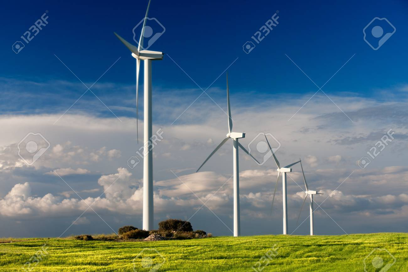 white wind turbine generating electricity on cloudy sky - 16255202