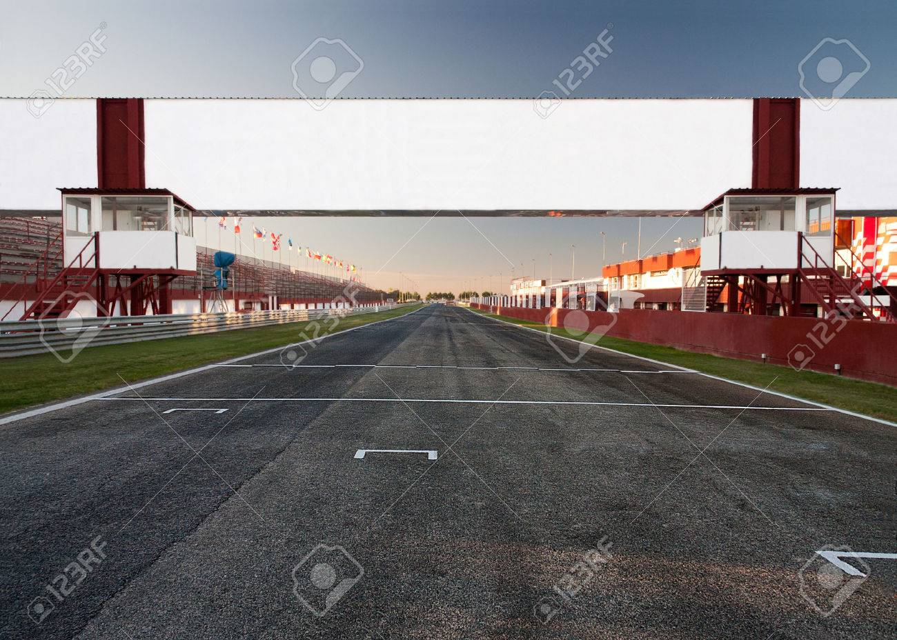 a racetrack with an empty board, for filling with text. It can be used as conceptual business picture. Focus is on the board - 37290625