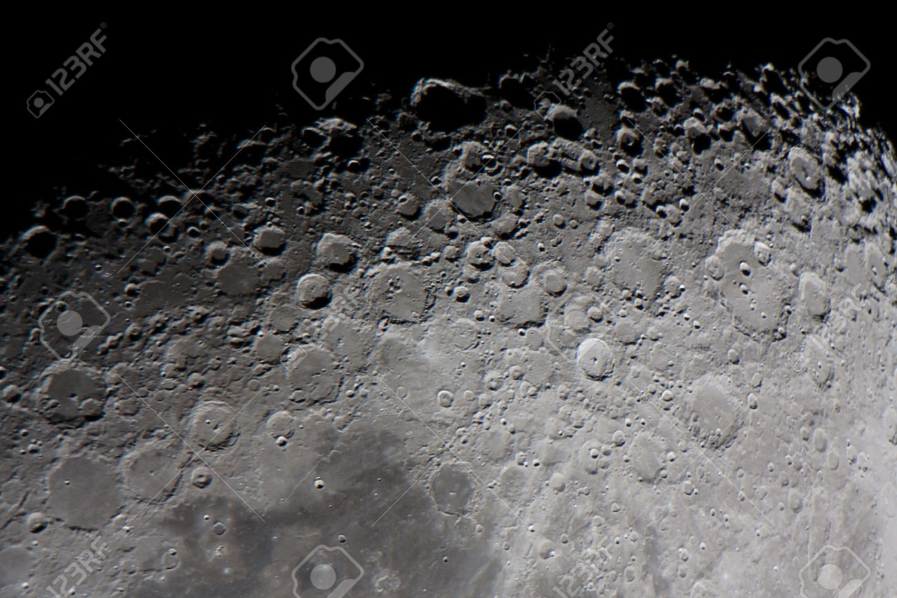 """real picture of the moon surface taken by telescope, focused in the twilight zone, called as well """"terminator of the moon"""" or """"grey line"""" - 38251092"""