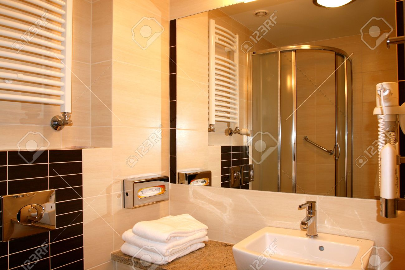 modern exclusive hotel bathroom interior. mirror reflection. stock