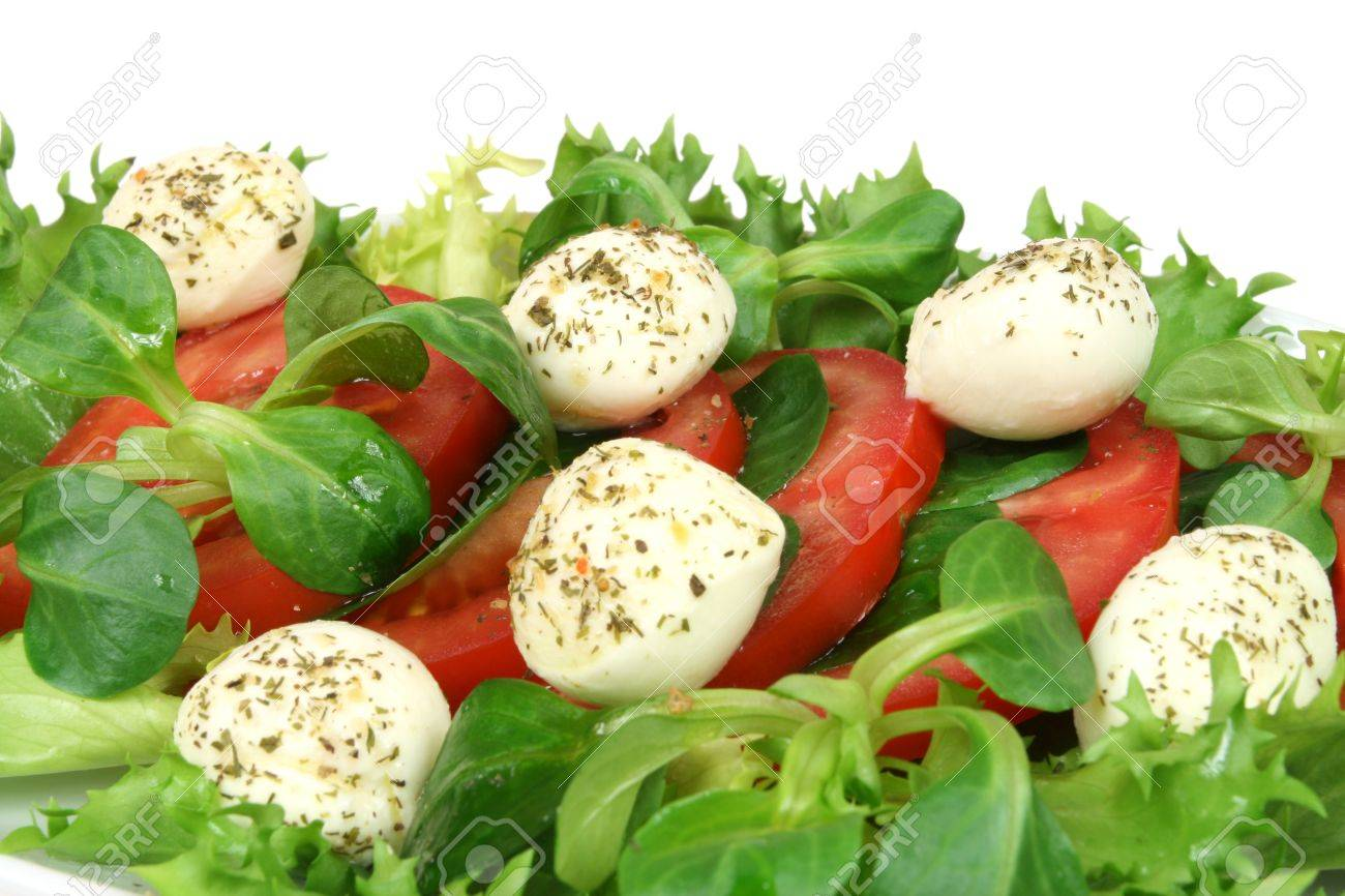 Healthy And Colorful Vegetable Salad Tomato Rocket Plant Arugula And Mozzarella With
