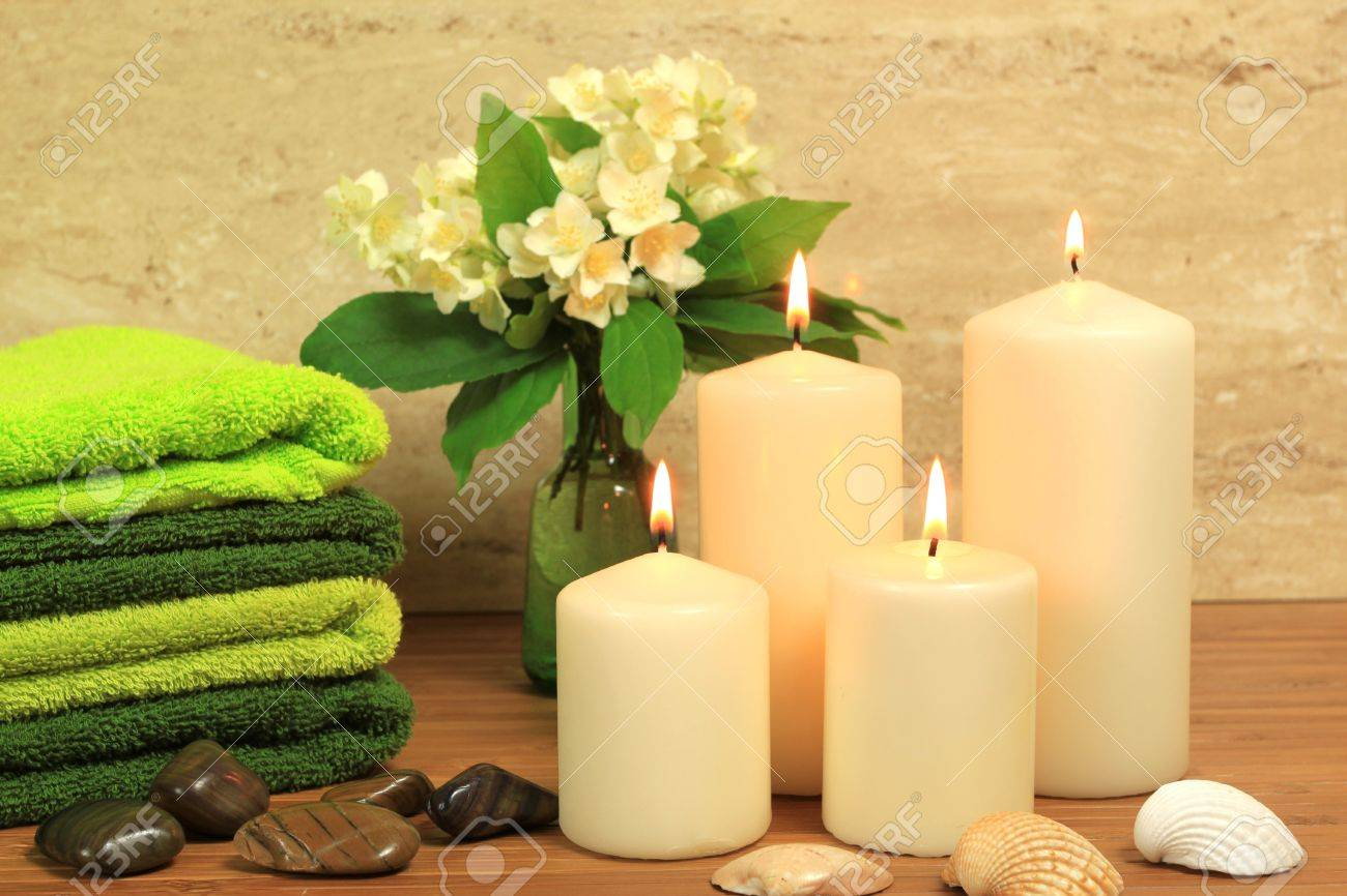 Spa resort composition - candles, towels, zen stones Stock Photo - 7197220