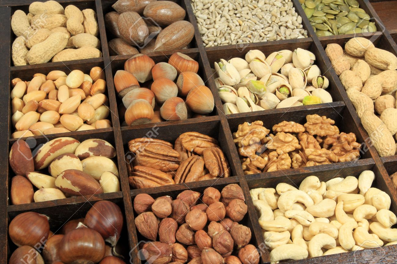 Varieties of nuts: peanuts, hazelnuts, chestnuts, walnuts, cashews, pistachio and pecans. Also sunflower and pumpkin seeds. Food and cuisine. Stock Photo - 8246010