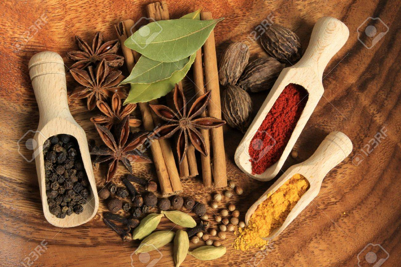 Cooking ingredients - warm colours of herbs and spices. Stock Photo - 9764622