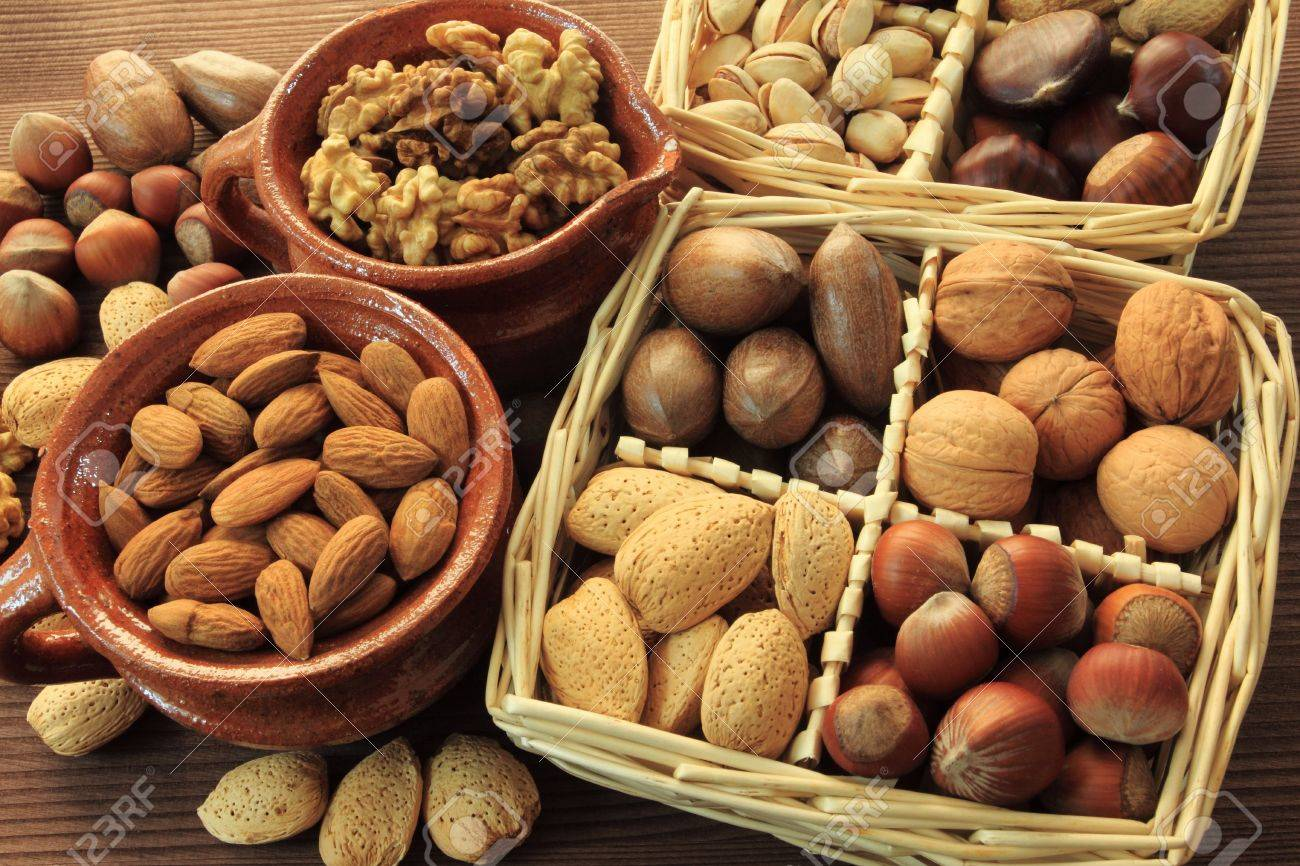 Varieties of nuts: peanuts, hazelnuts, chestnuts, walnuts,  pistachio and pecans. Food and cuisine. Stock Photo - 11297711