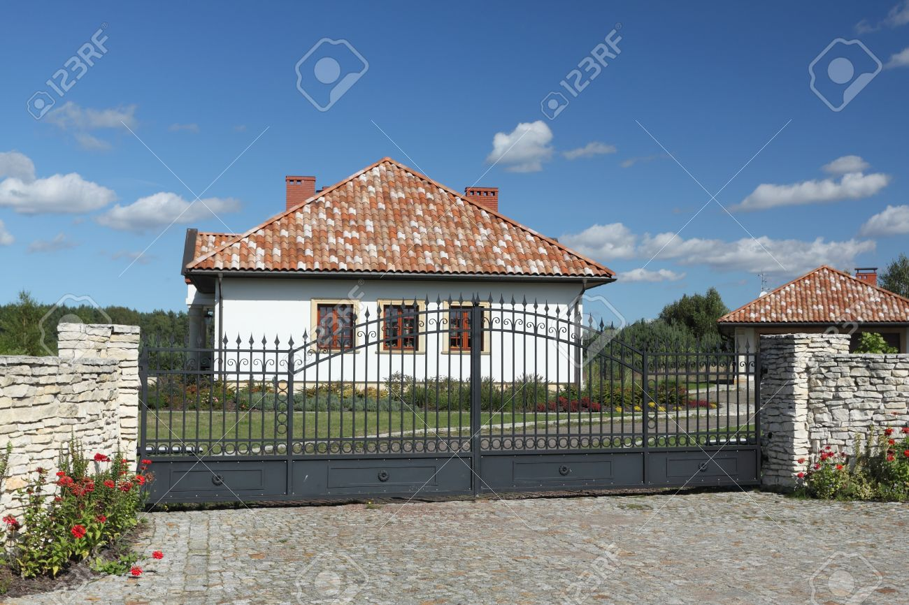 Beautiful white house with a terracotta roof tiles. - 16681879