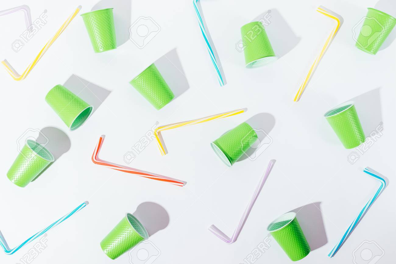 flat lay pattern decoration of disposable cups and straws overhead