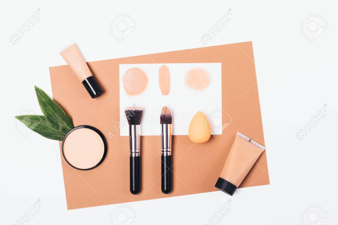 Makeup Products On Brown Paper Flat Lay Frame Foundation Concealer Stock Photo Picture And Royalty Free Image Image 126423678