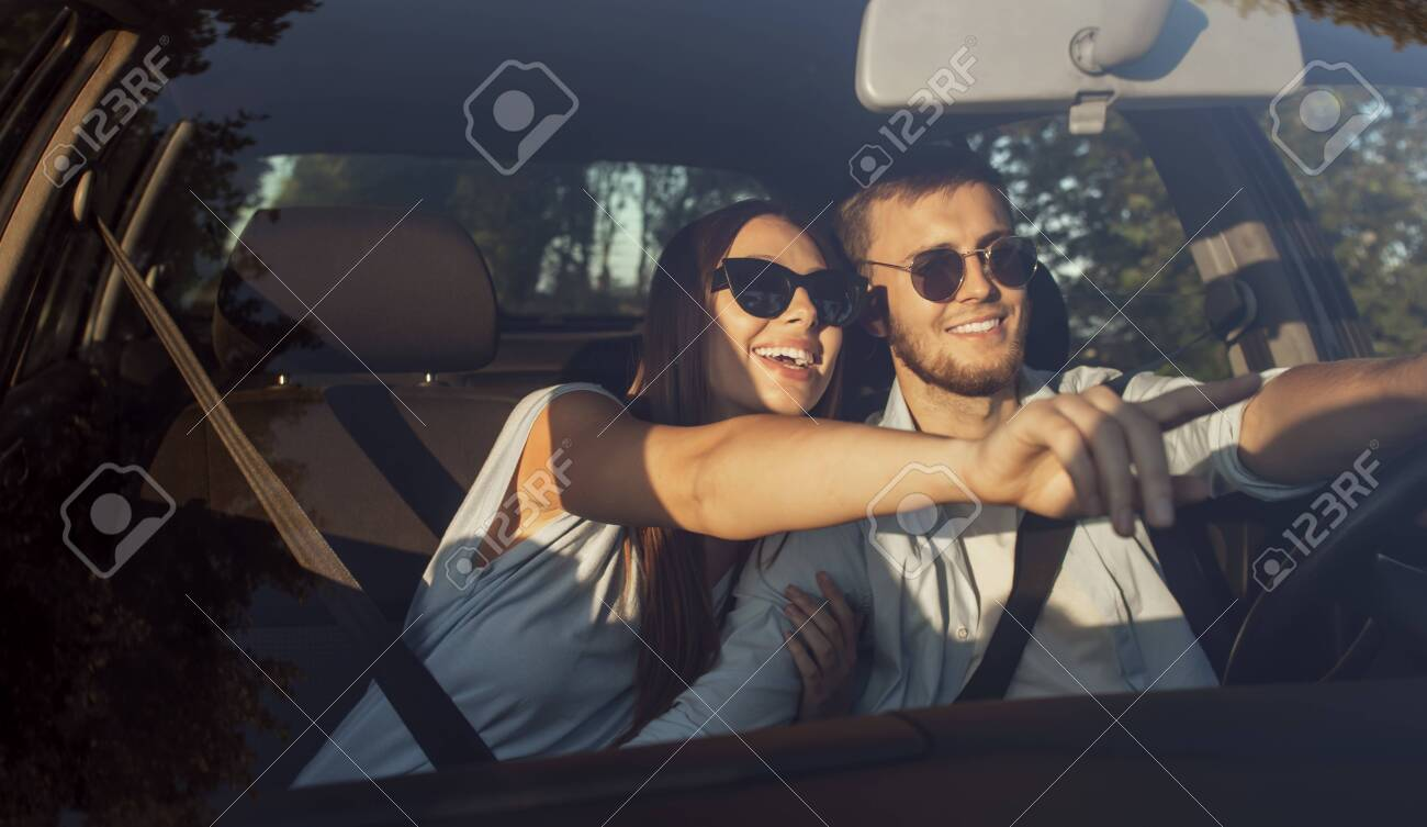 Loving couple travelling by car has noticed a nice place to stop and rest - 145147752