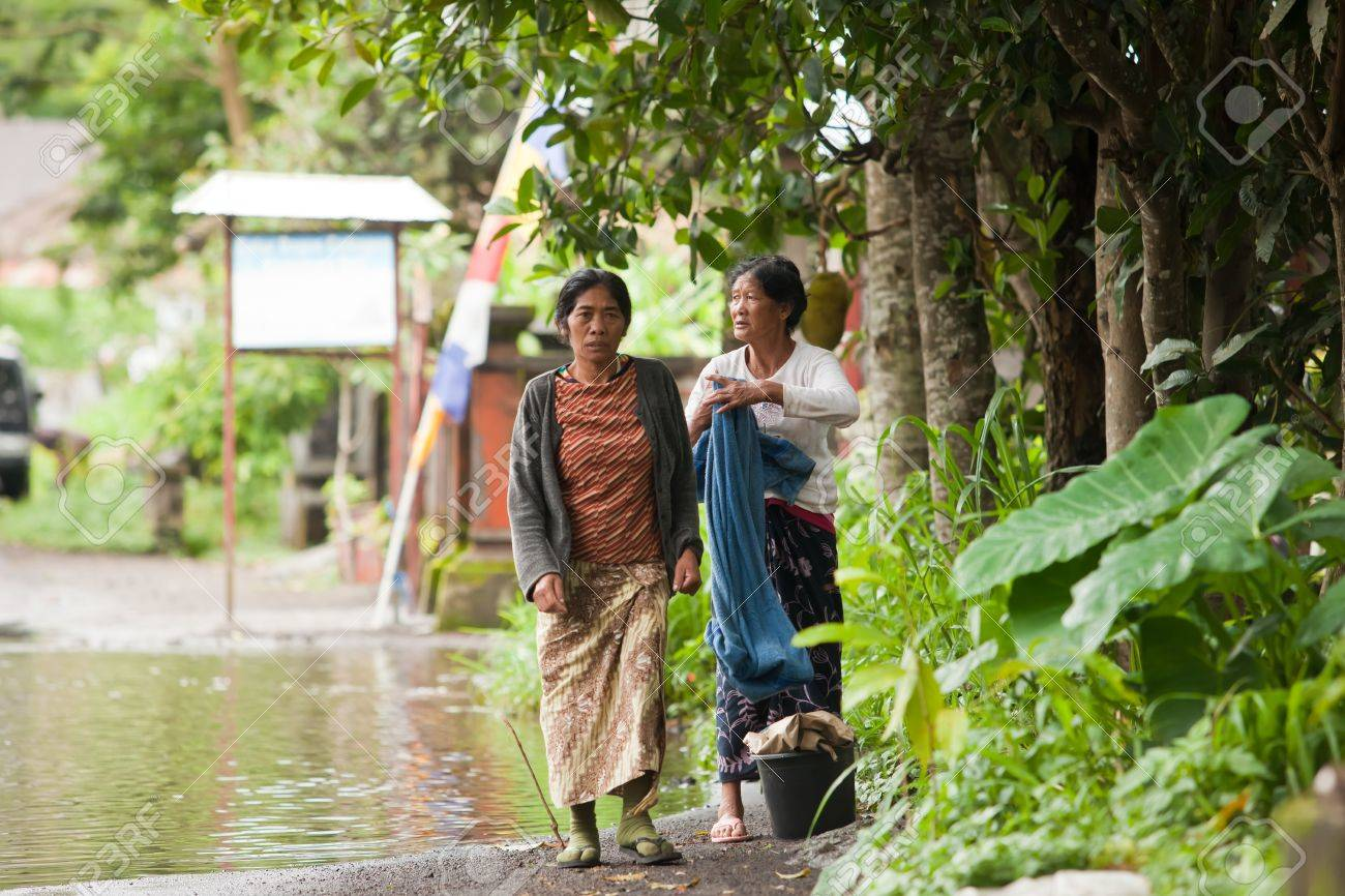 Lake Batur Bali January 21 Women Walking Through Flooded Stock