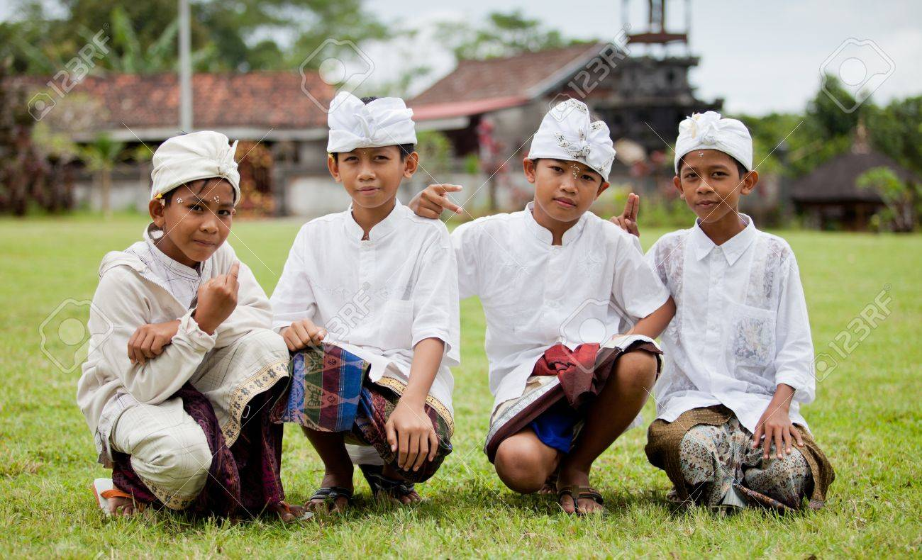 BALI - JANUARY 22. Balinese pilgrim children at Mother Temple in Besakih on January 22, 2012 in Bali, Indonesia. Most Balinese hindus make a yearly pilgrim to the mother of all temples in Bali. Stock Photo - 12444875