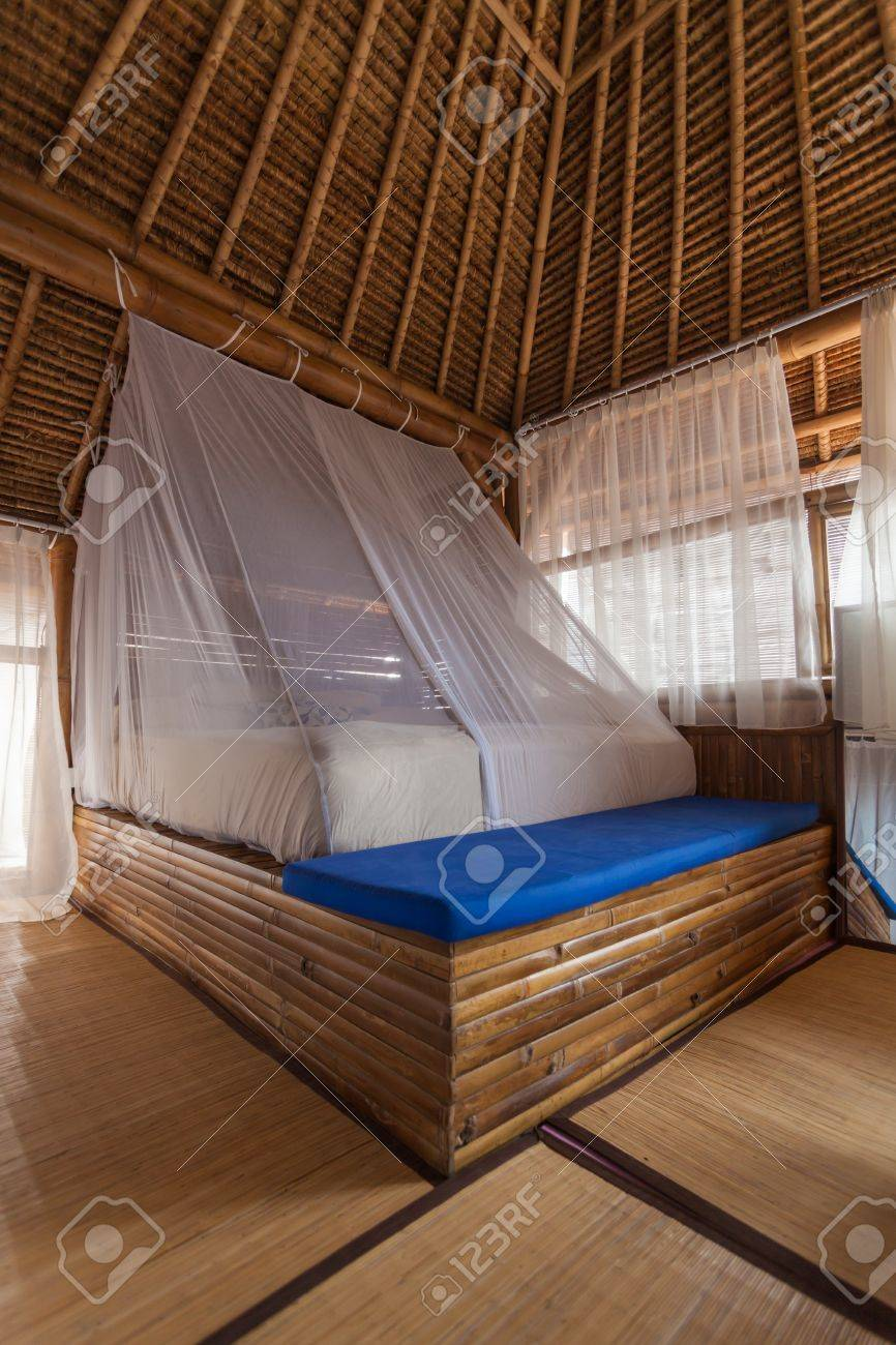 Bamboo bed in a bamboo bedroom in a bamboo house Stock Photo - 13669989
