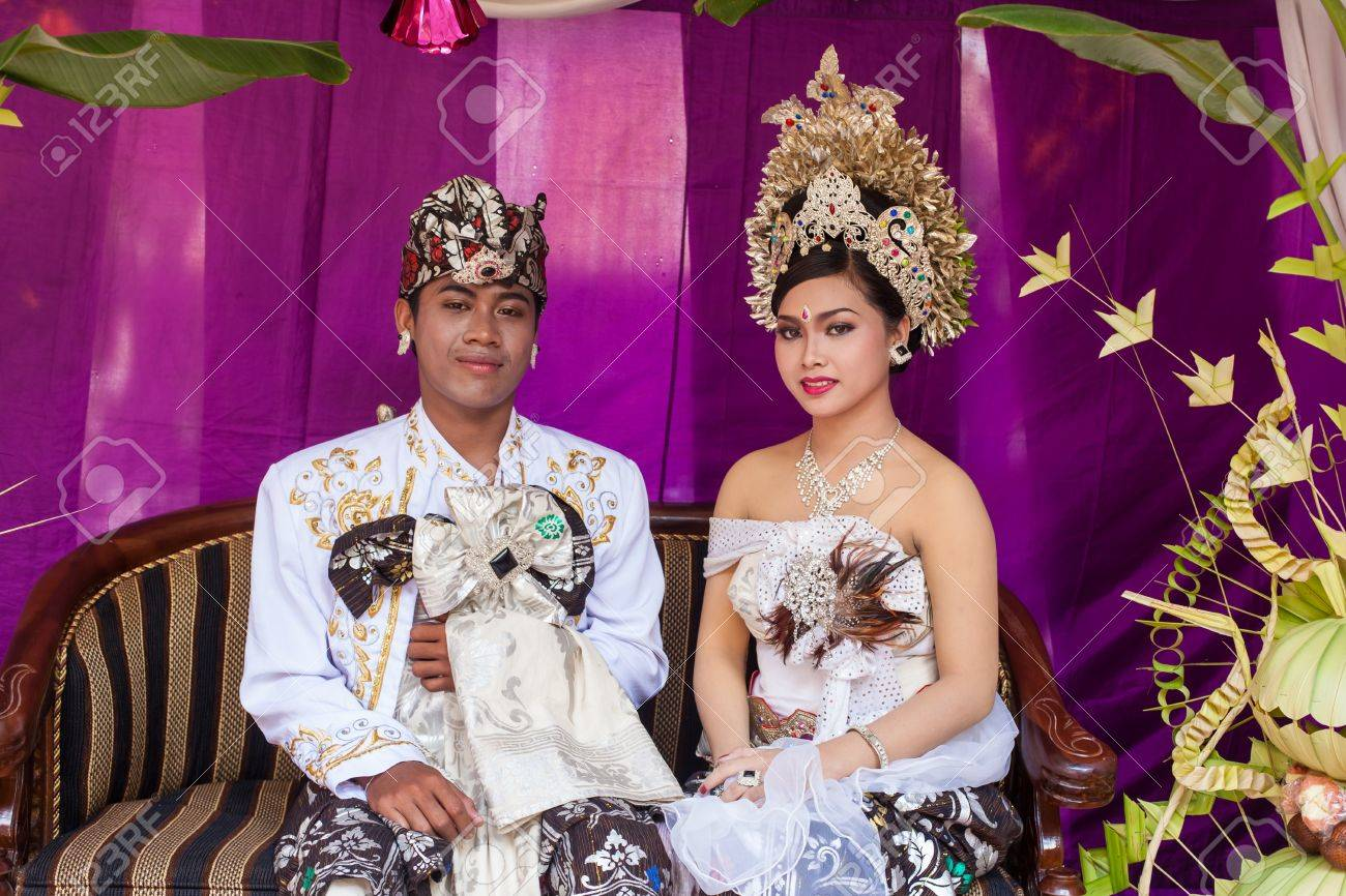 BALI - FEBRUARY 11. Couple enacting wedding scene in preparation for religious ceremony on February 11, 2012 in Bali, Indonesia. Most Balinese get married in their early 20s. Stock Photo - 13666250