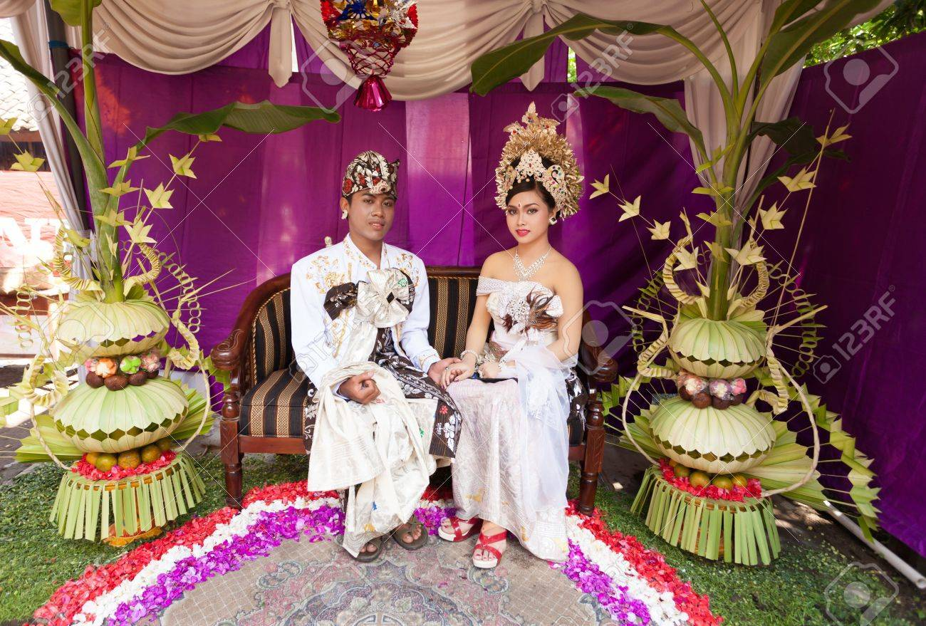 BALI - FEBRUARY 11. Couple enacting wedding scene in preparation for religious ceremony on February 11, 2012 in Bali, Indonesia. Most Balinese get married in their early 20s. Stock Photo - 13666247
