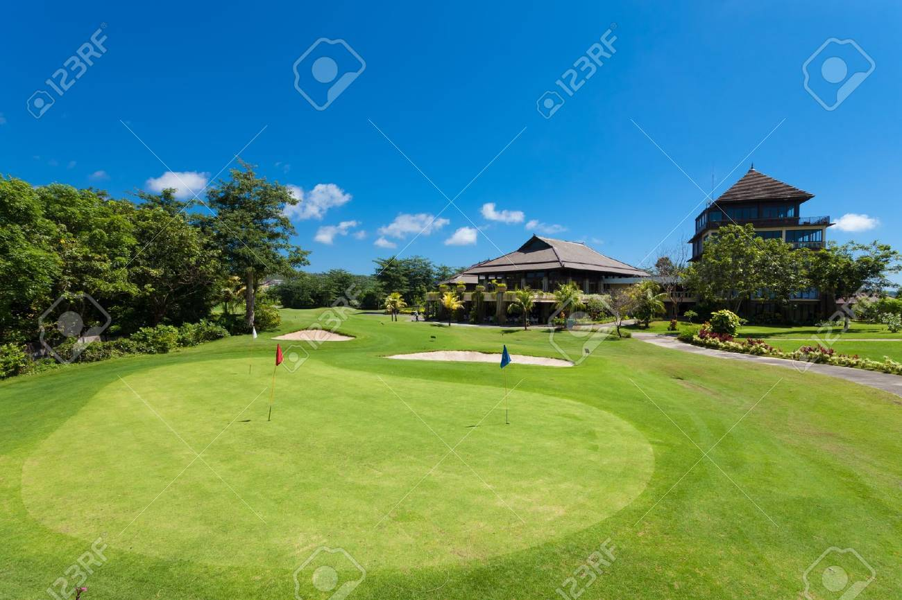 Green and holes in front of Golf clubhouse in Bali, Indonesia - 13669996