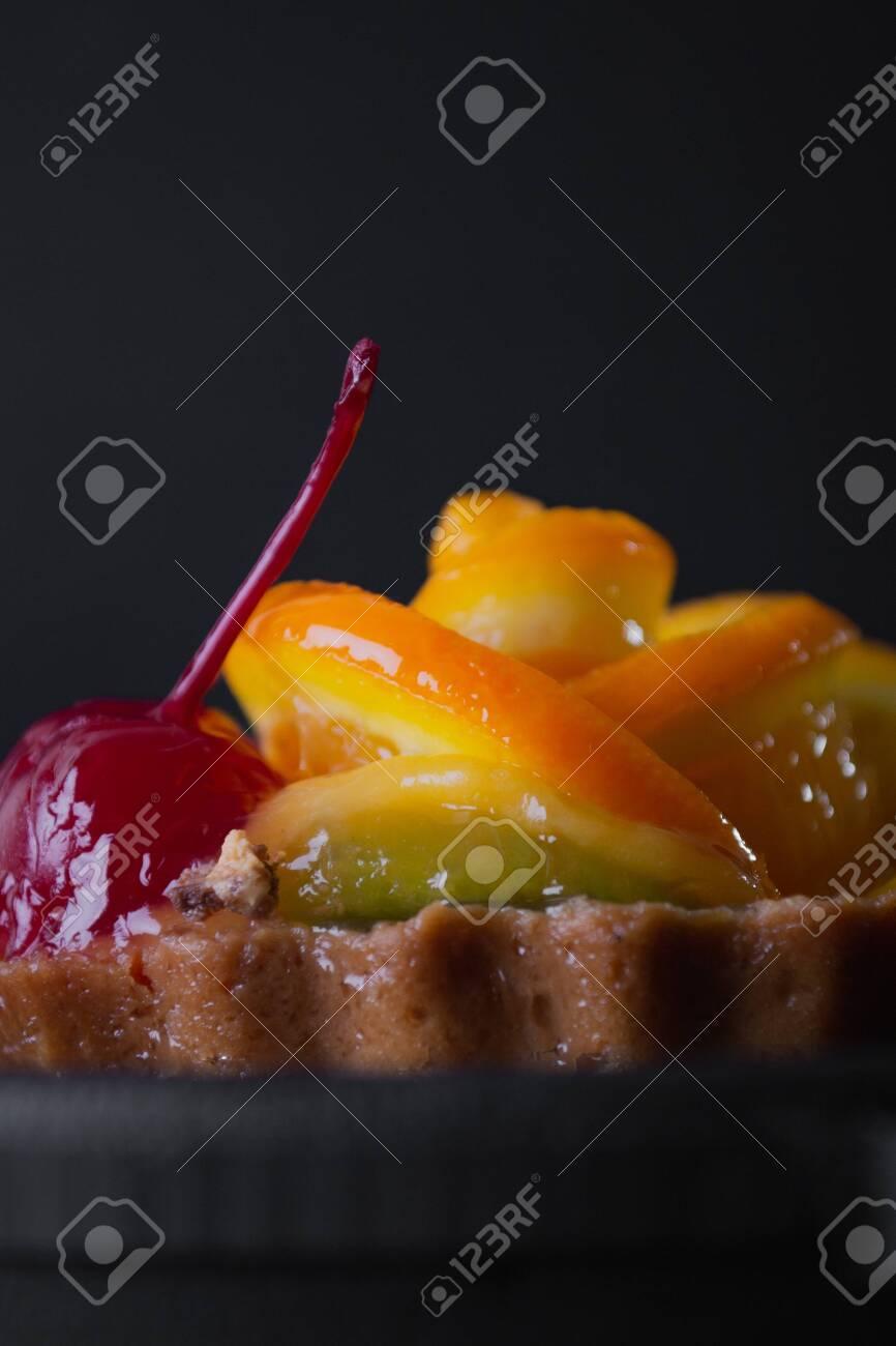 Cheese dessert with orange on a black background. - 154903193