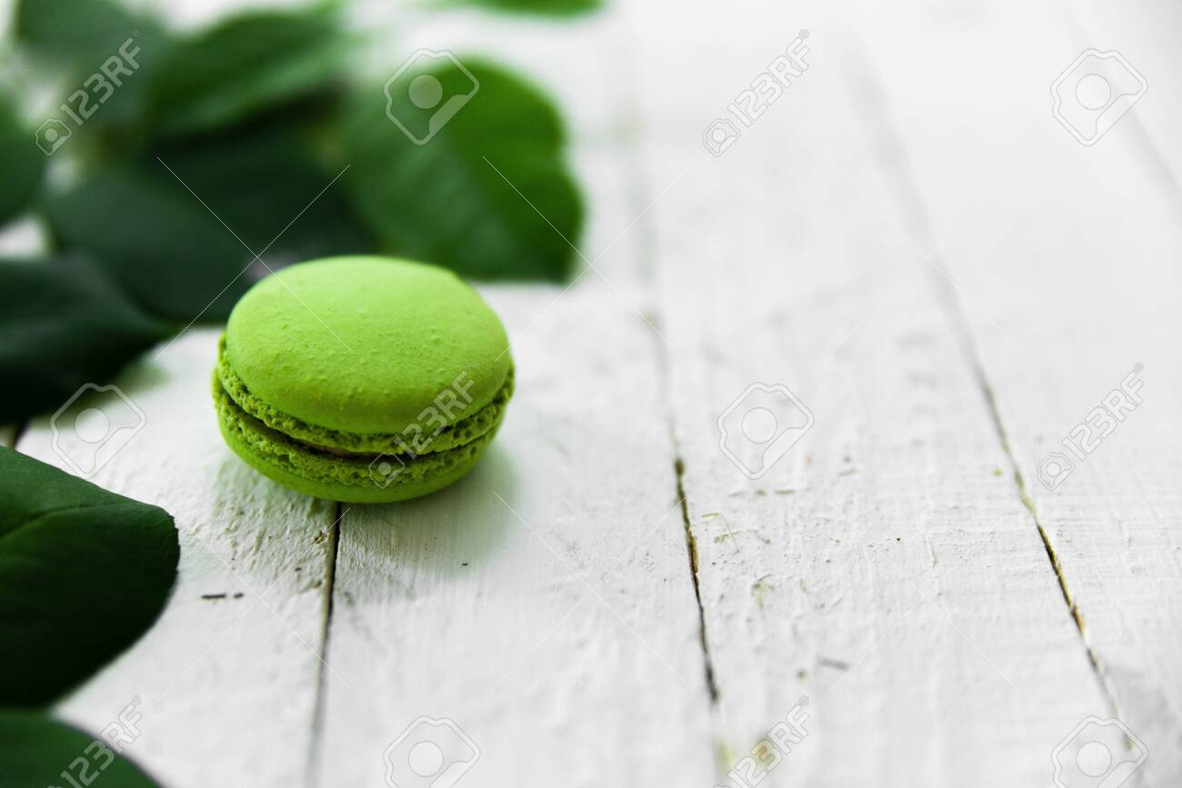 Green macaroon food photo with green leaves. - 154904196
