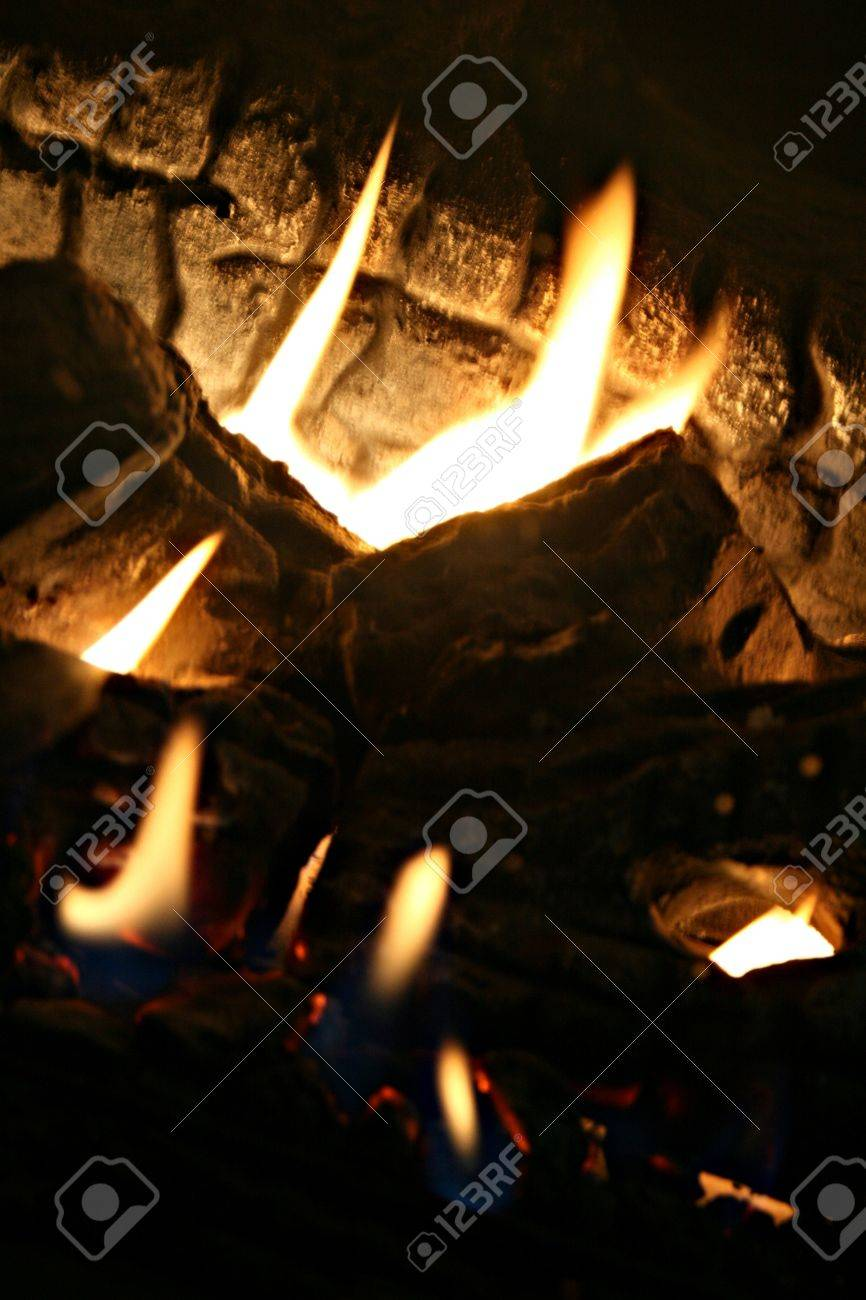 Multiple flames among the fire are higlighted in an abstract way by tilting the image to the right Stock Photo - 18879647
