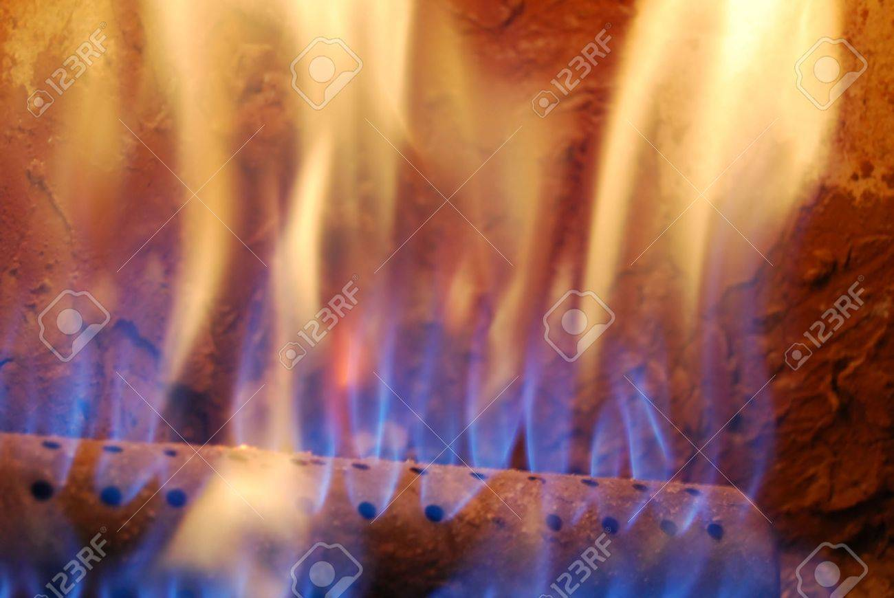 Flames Of Blue And Orange Natural Fire In Warm Gas Furnace Or ...