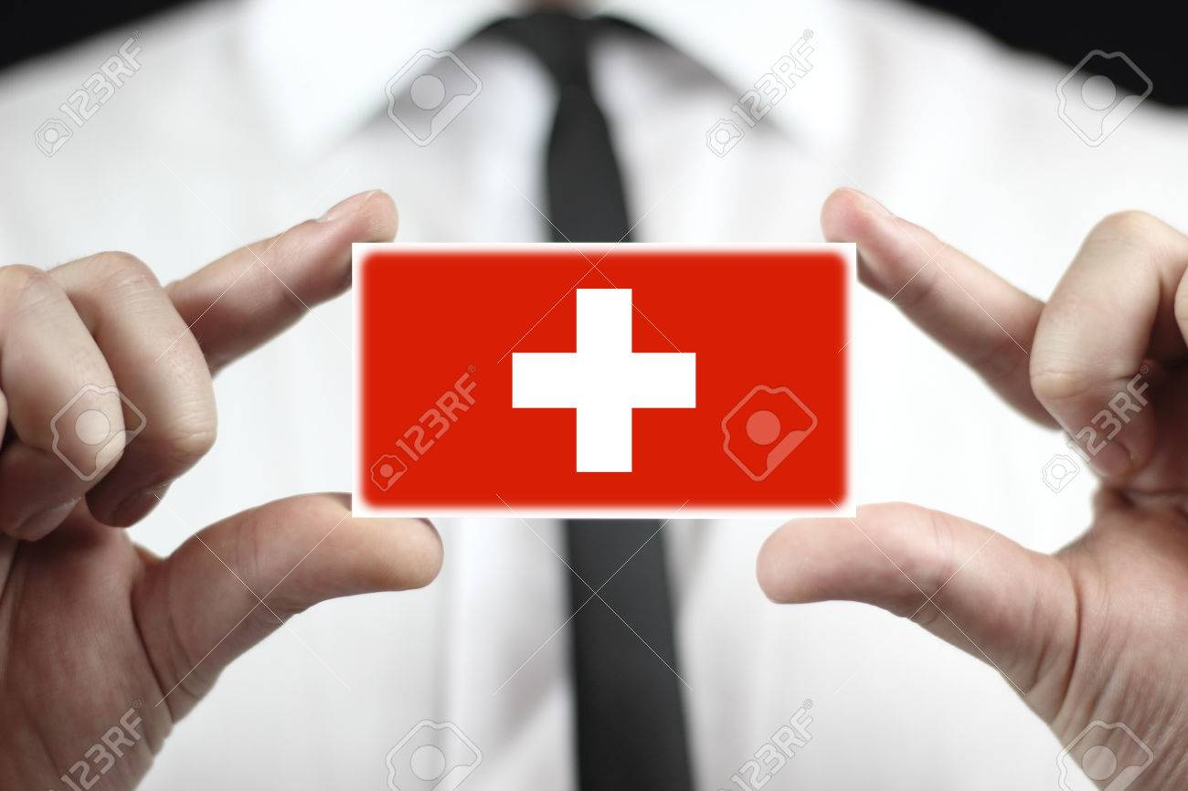 Businessman holding a business card with a switzerland flag stock businessman holding a business card with a switzerland flag stock photo 22483868 colourmoves