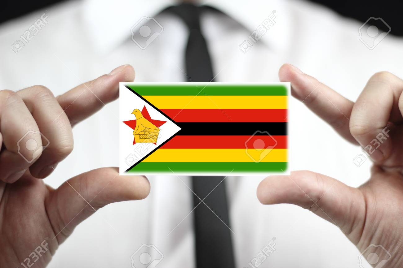 Businessman holding a business card with zimbabwe flag stock photo businessman holding a business card with zimbabwe flag stock photo 25364999 reheart Image collections