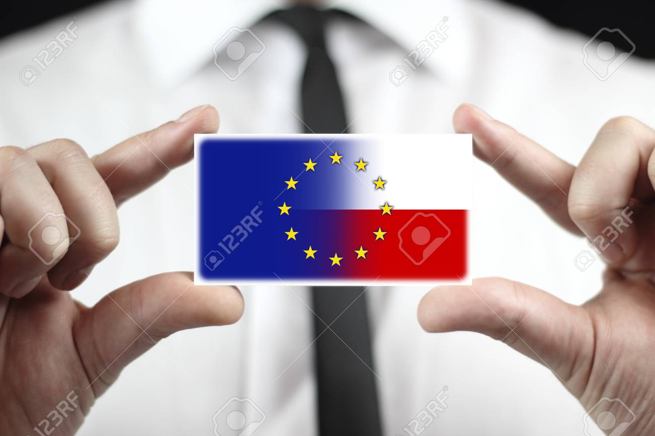 Businessman Holding A Business Card With Poland And European.. Stock ...
