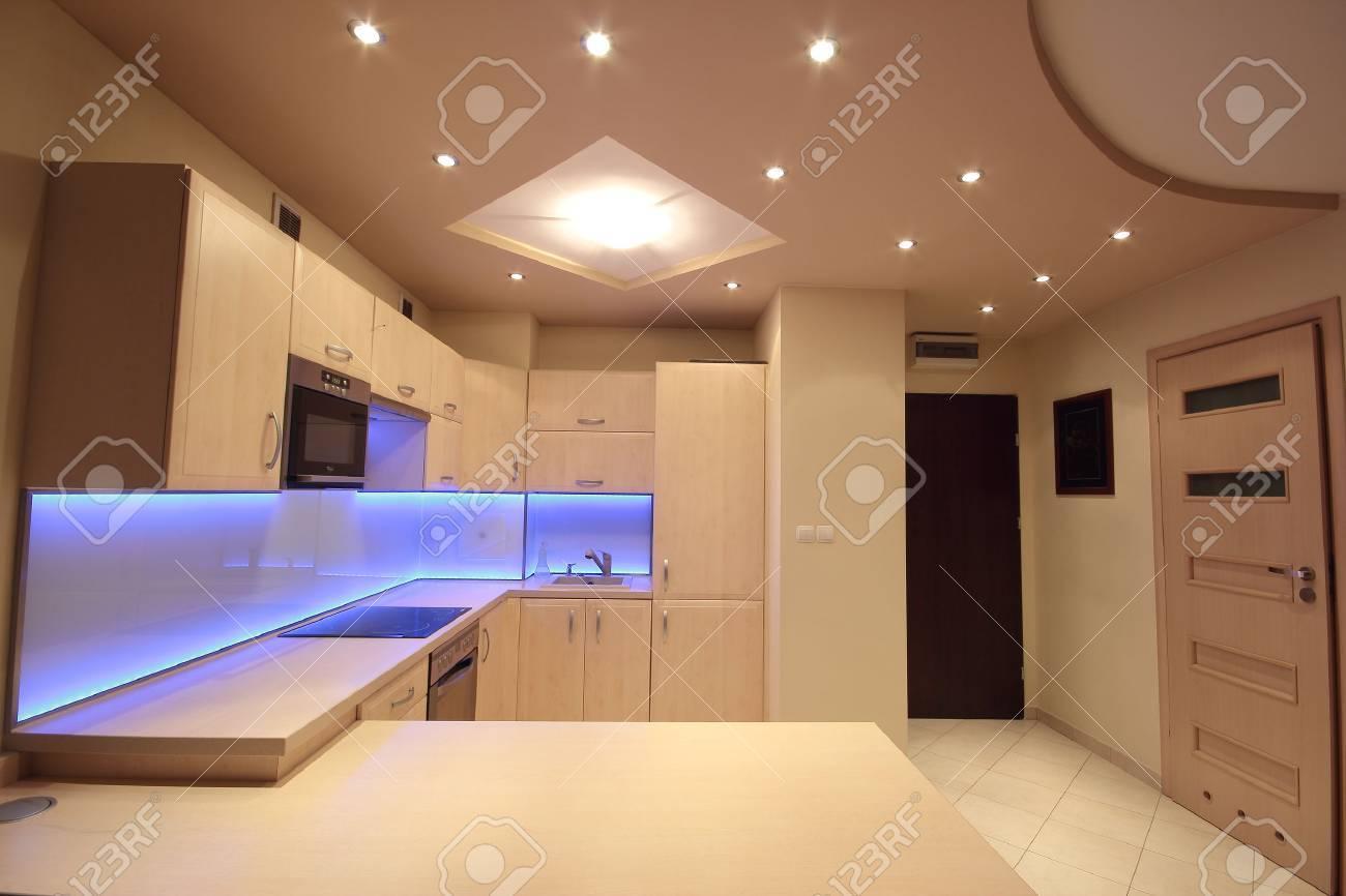 Modern luxury kitchen with purple LED lighting - 38922182