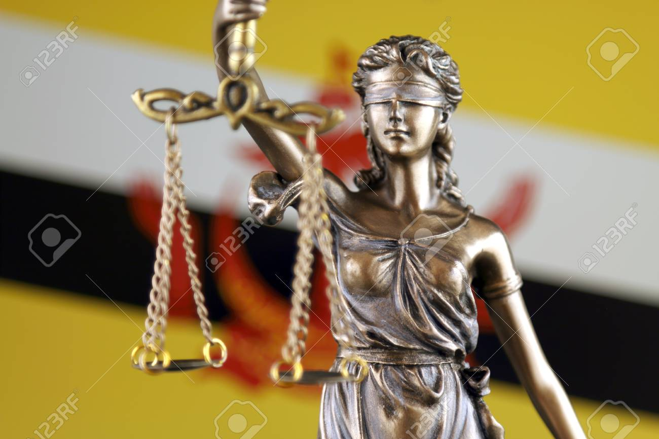 Symbol Of Law And Justice With Brunei Flag Close Up Stock Photo
