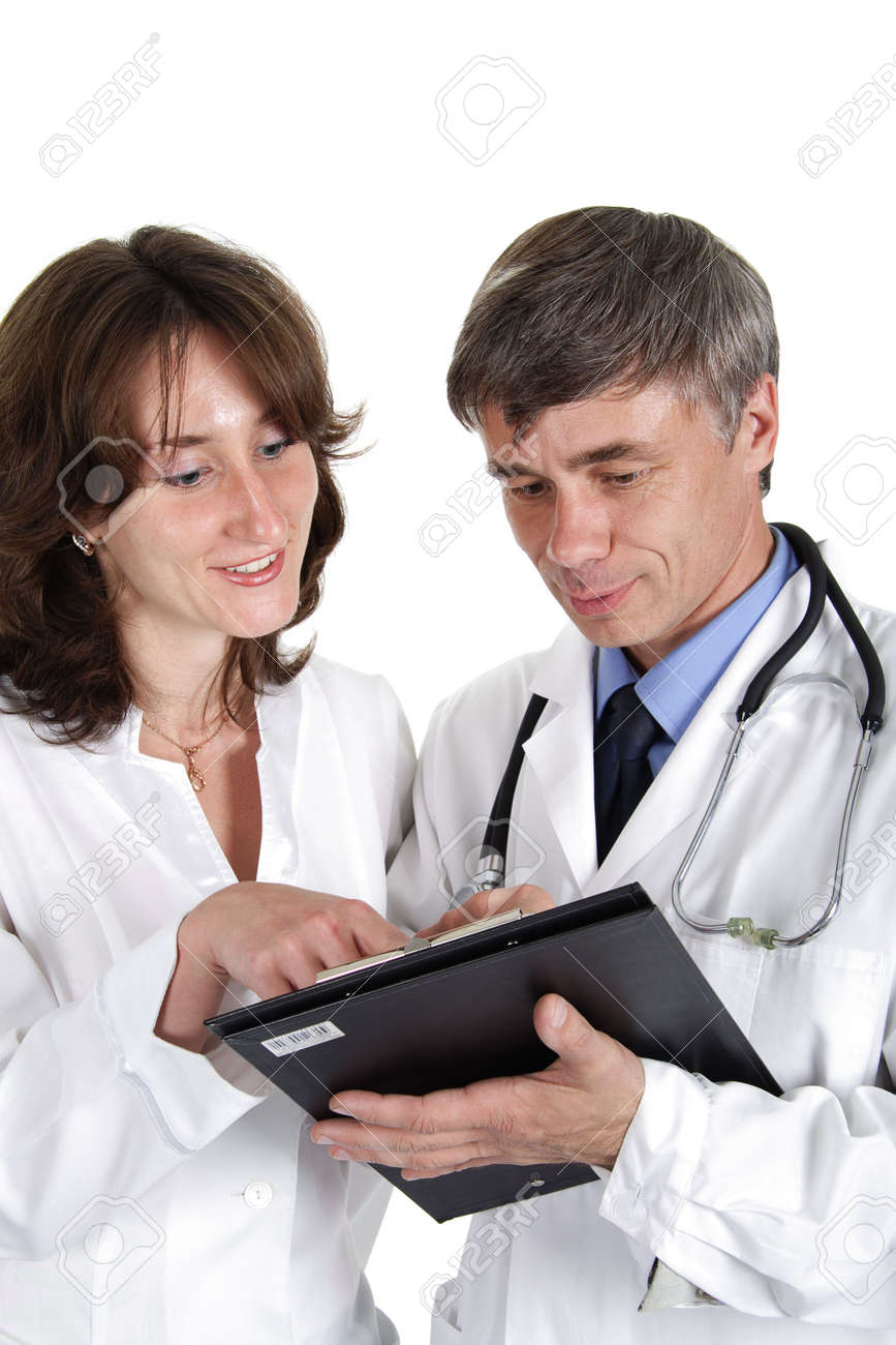 Two doctors review some case notes. Stock Photo - 834065