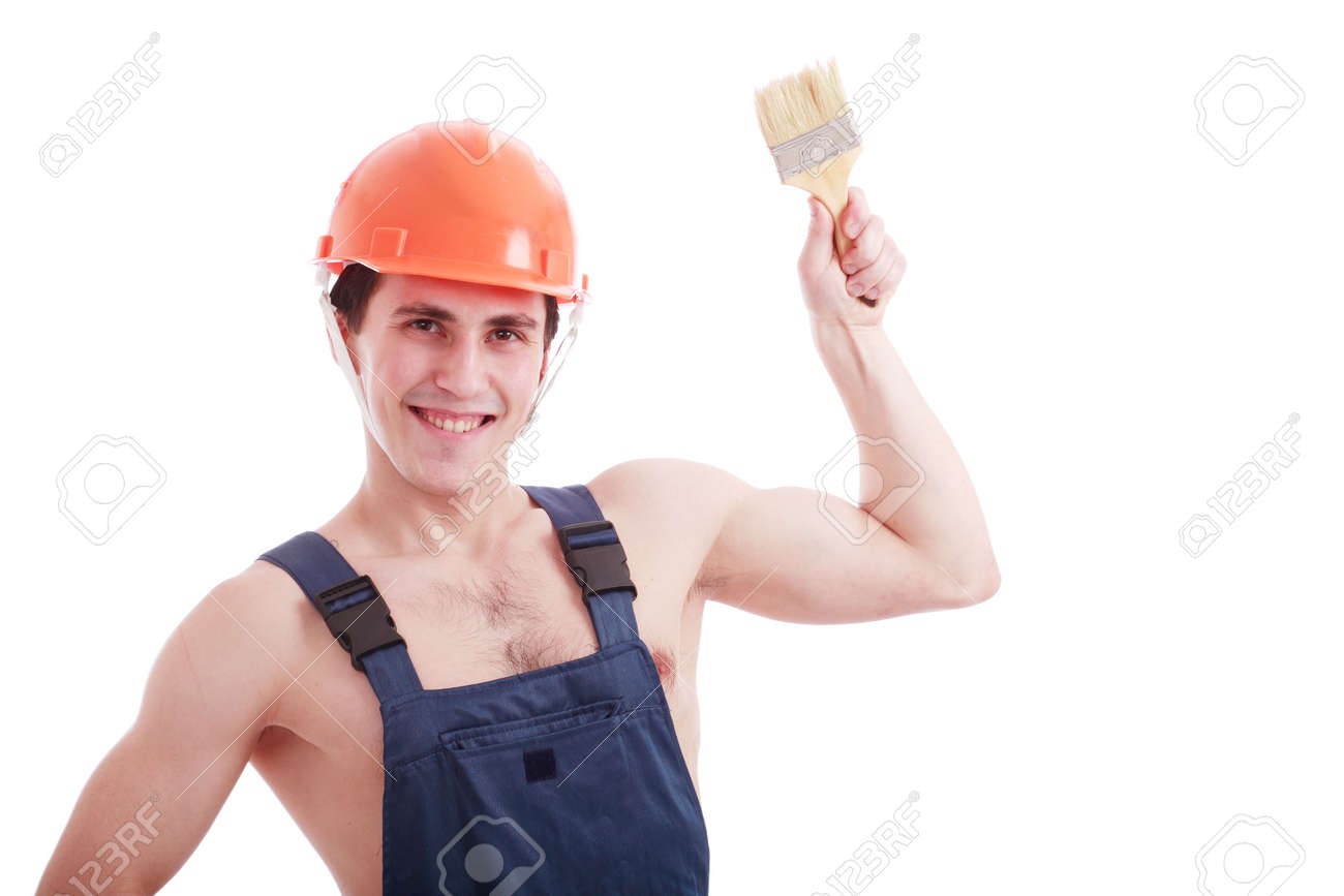 Muscular young man in a builder uniform with tools. Stock Photo - 2353961