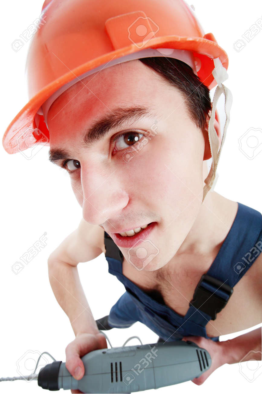 Muscular young man in a builder uniform with tools. Stock Photo - 2589695