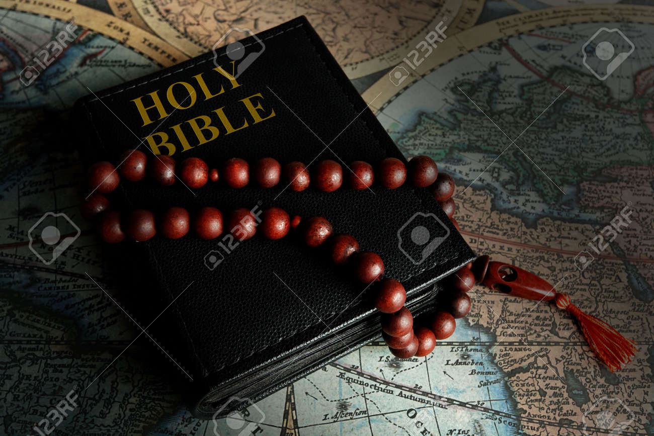 The holy bible with beads Stock Photo - 3309817