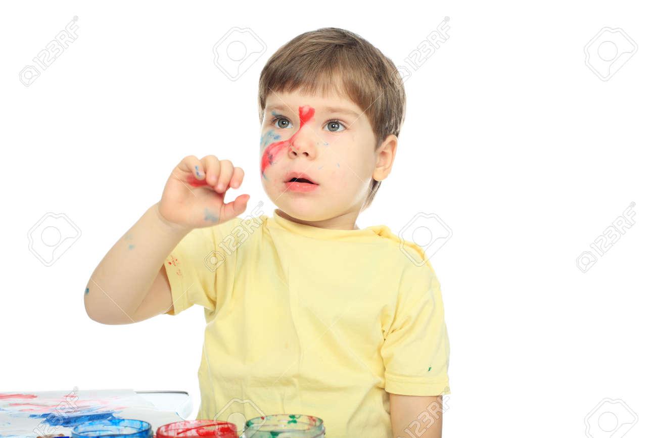 Beautiful child enjoying his game. Shot in a studio. Stock Photo - 4218094