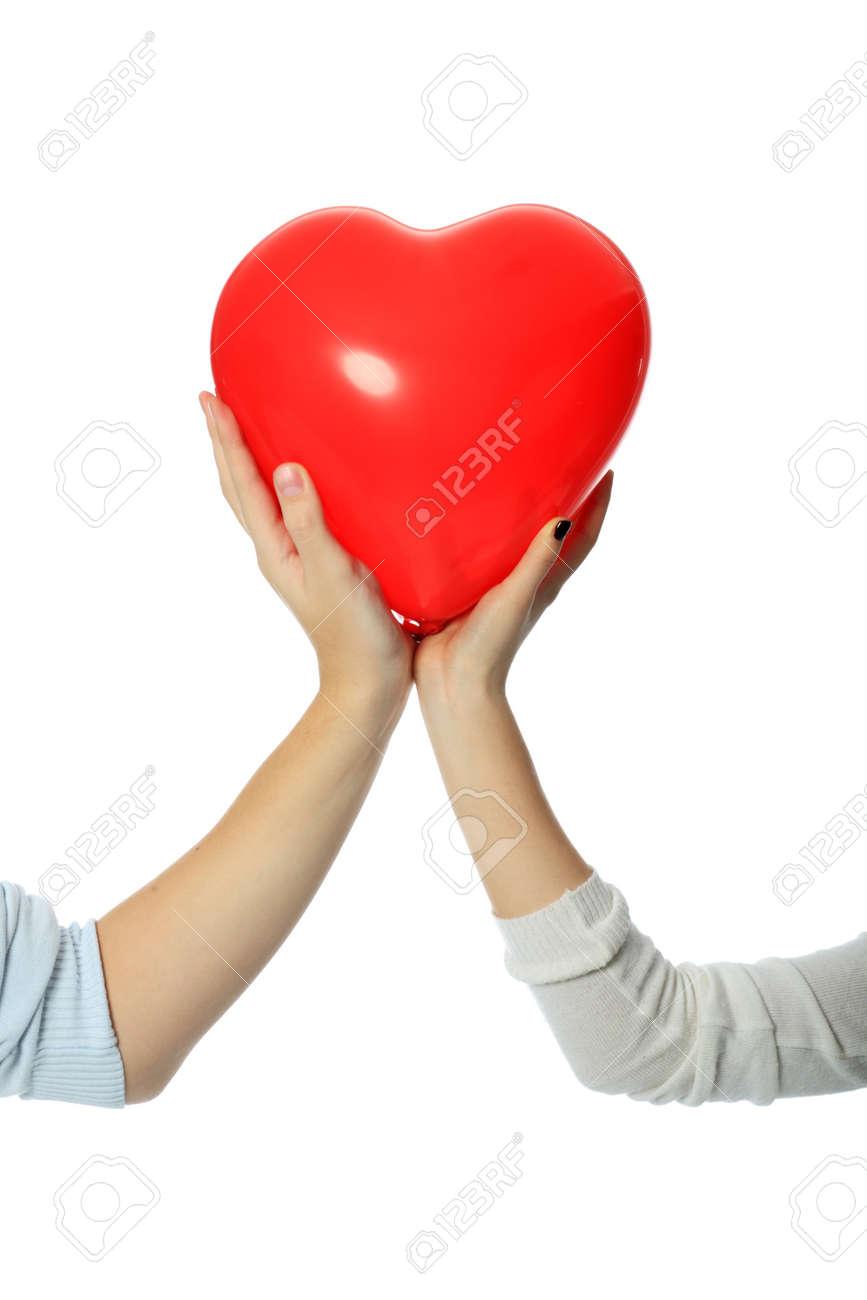 Tema De Amor Corazón Rojo En Manos De Personas Enamoradas Fotos