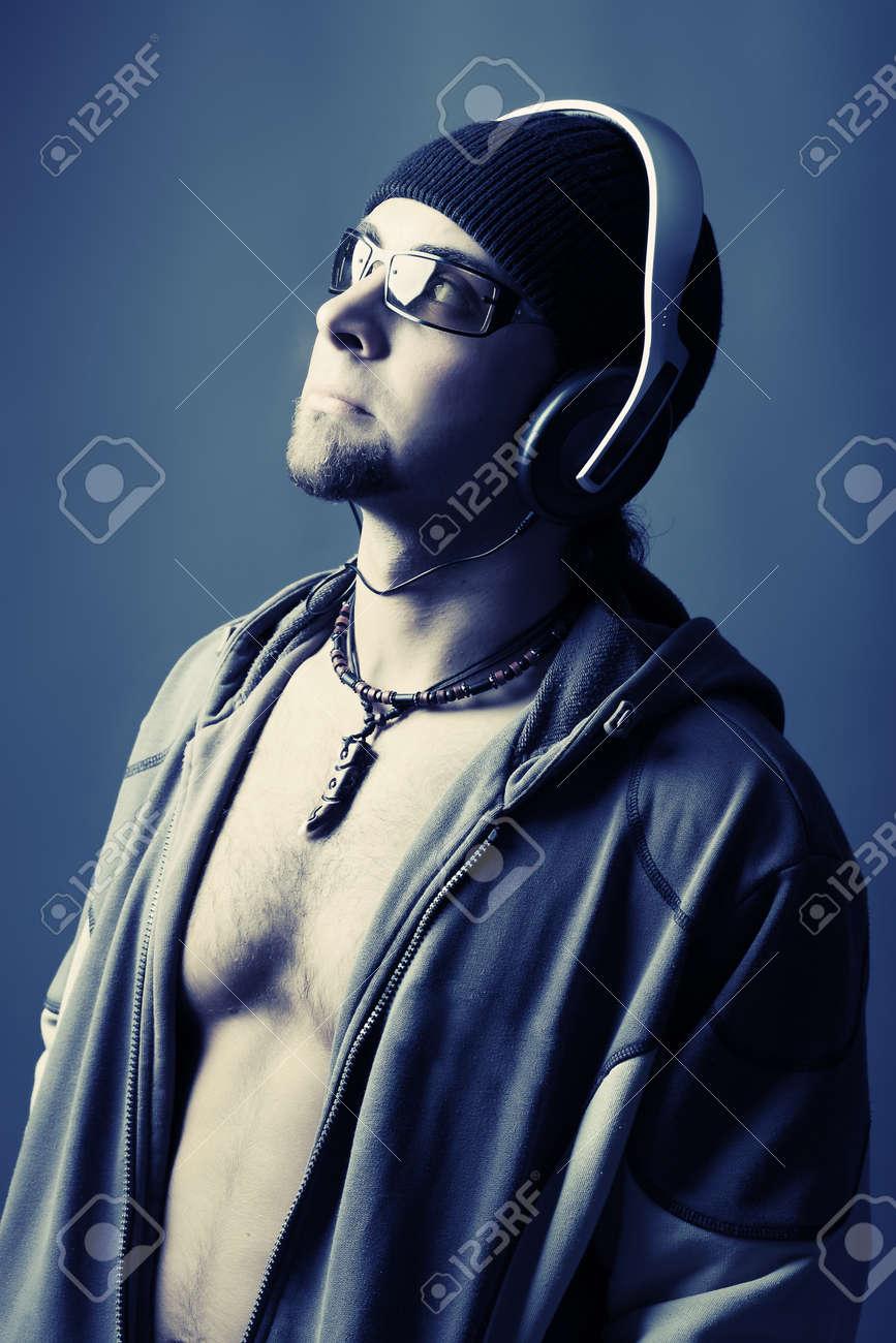 Handsome man in headphones enjoying the music Stock Photo - 4347352