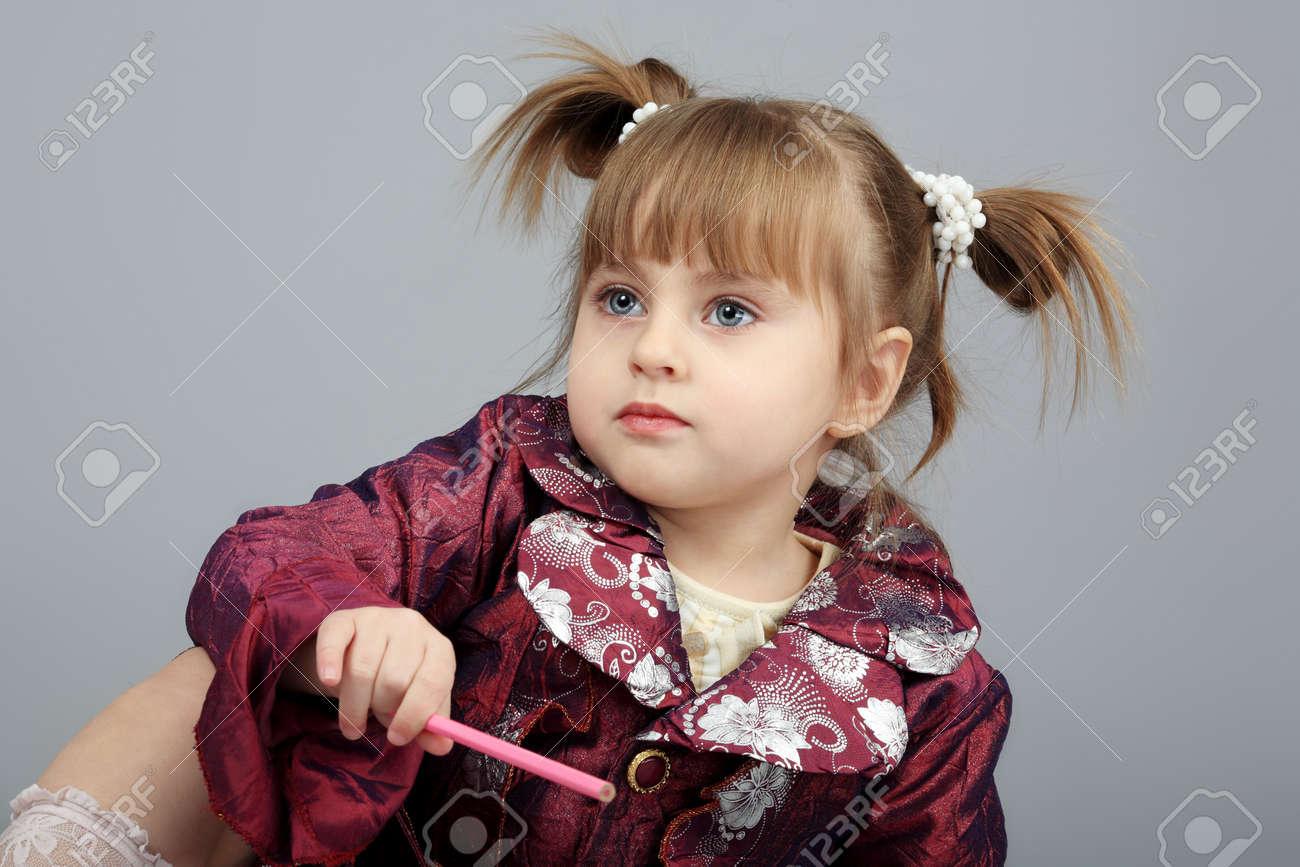 Beautiful emotion girl. Shot in a studio. Stock Photo - 4500463