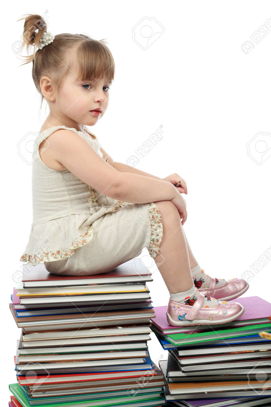 Portrait of a pretty girl with books. Stock Photo - 4500388
