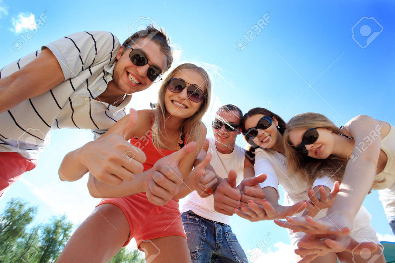 Cheerful young people having fun on a beach. Great summer holidays. Stock Photo - 5073899