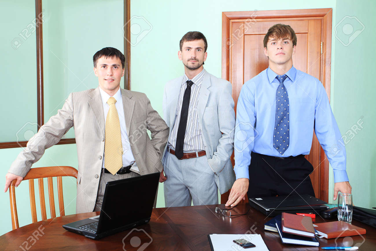 Business theme: business people in a work process in office. Stock Photo - 5123873