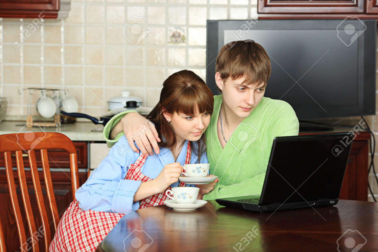 Happy young couple on a kitchen at home. Stock Photo - 5123600