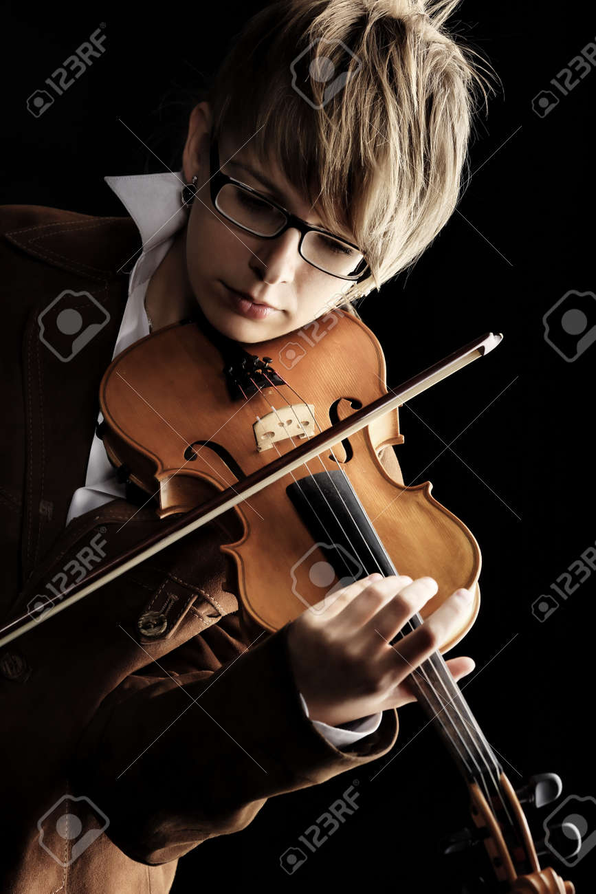 A young woman playing her violin with expression. Stock Photo - 5667634