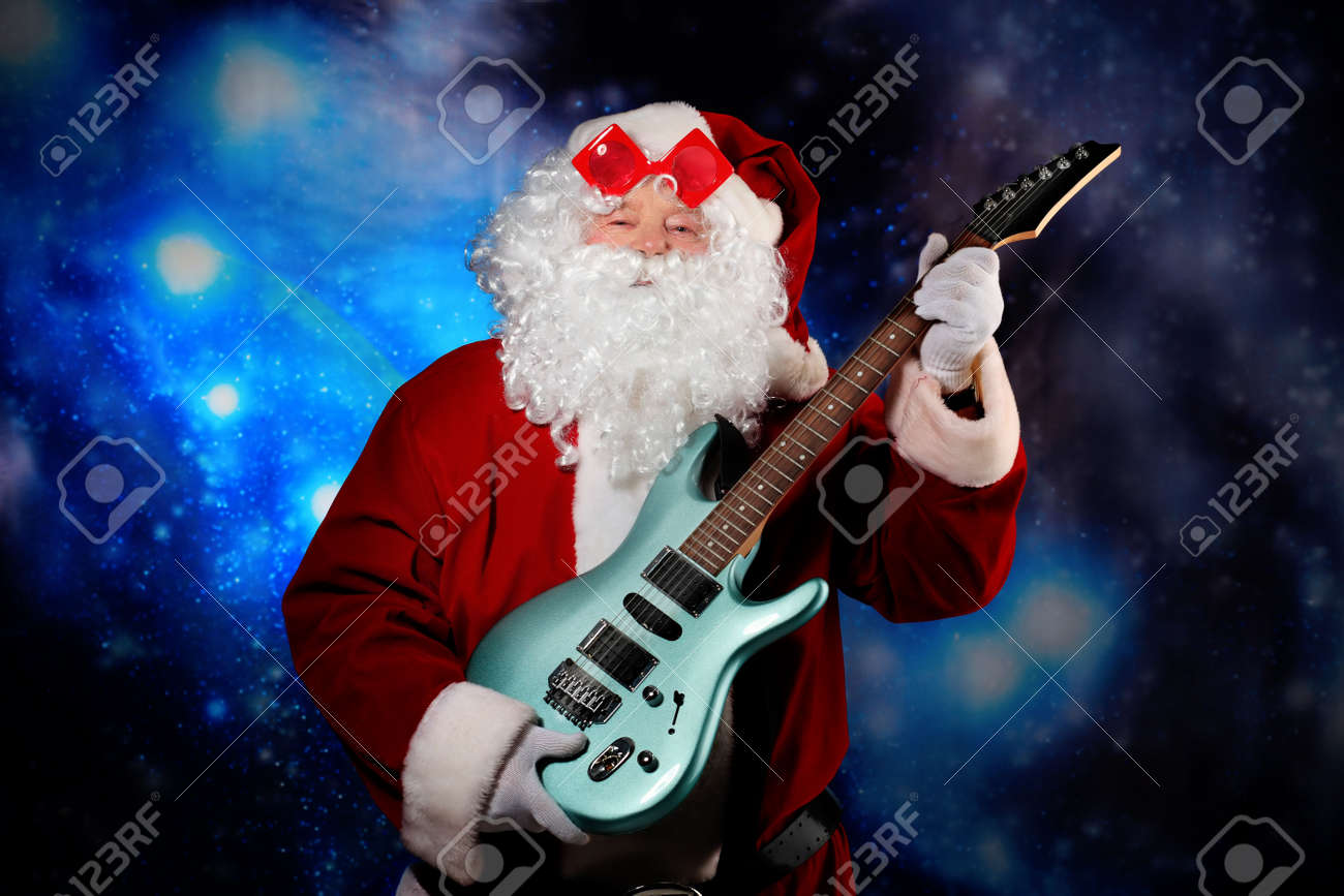 Christmas theme: Santa claus playing a guitar, snowy design. Stock Photo - 5889089