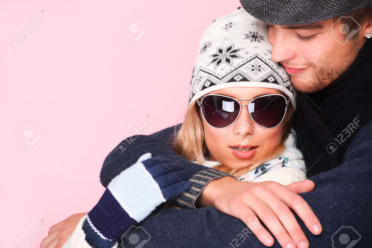 Portrait of embracing young couple in warm clothes. Stock Photo - 5924880