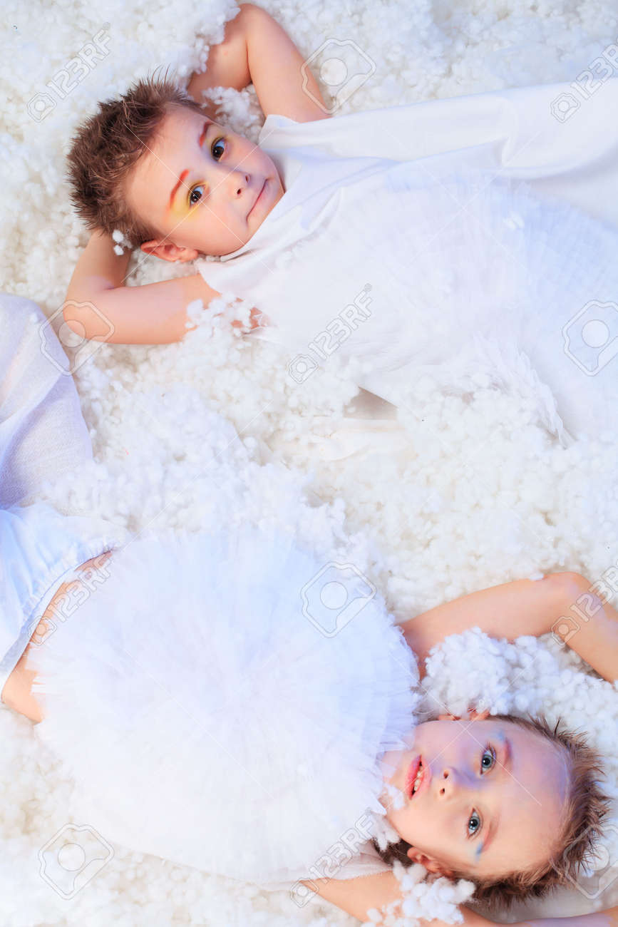 Beautiful little angels at a snowy background. Stock Photo - 5941841