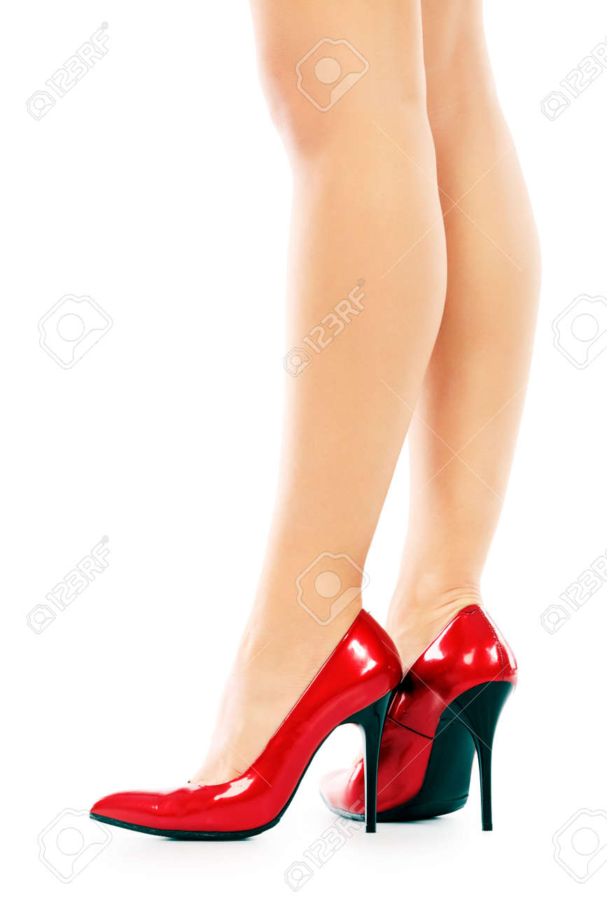 Female legs in elegant red shoes on white background Stock Photo - 6078734